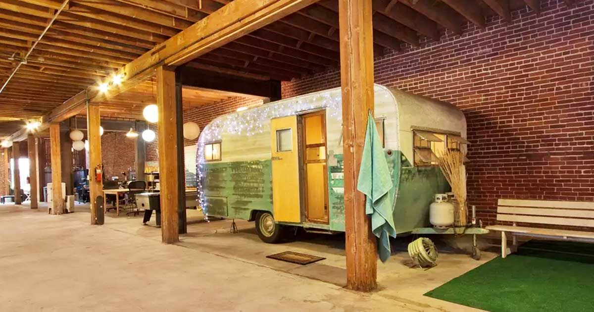 Come visit this 1954 trailer inside a gigantic loft and for Sf globe tiny homes